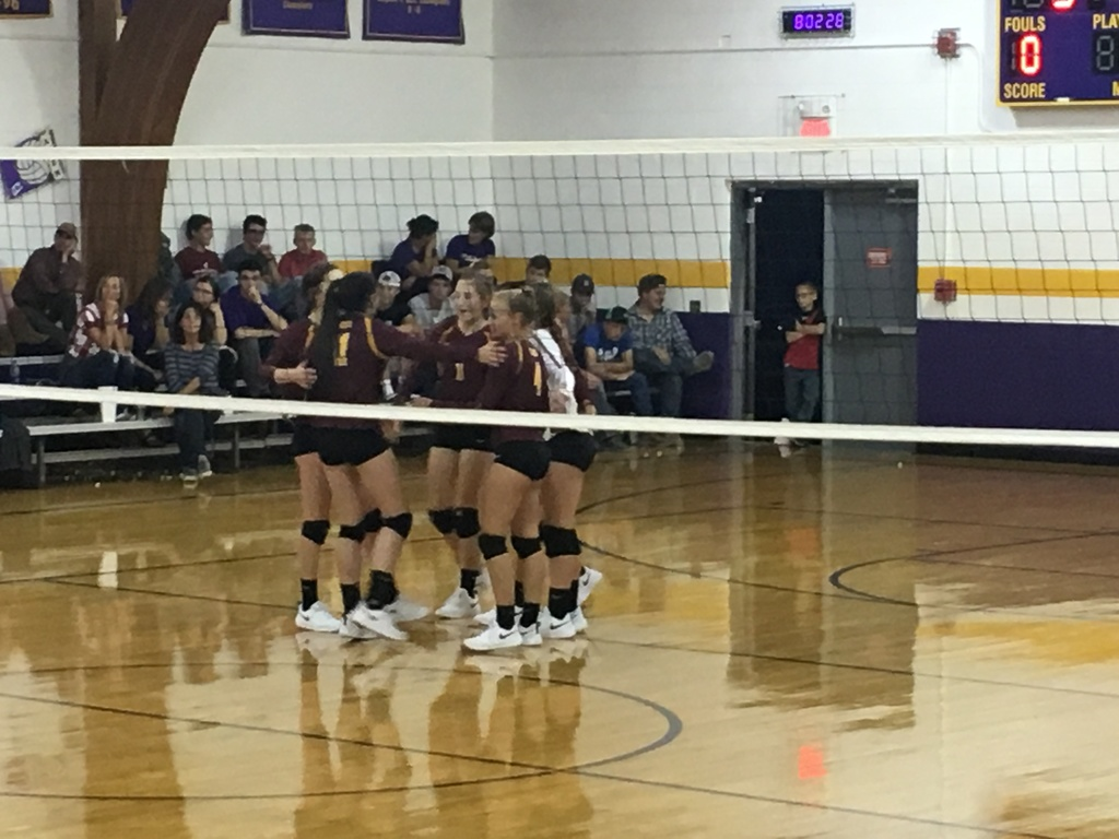 Lady Lion Volleyball players in team huddle