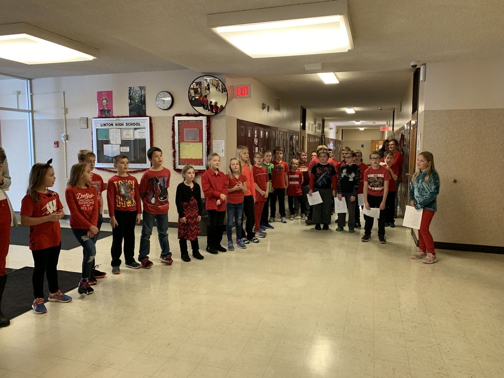 3rd and 4th grade caroling in the high school